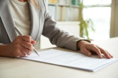 cropped-mid-section-of-unrecognizable-woman-signing-the-document_P-240x160.jpg